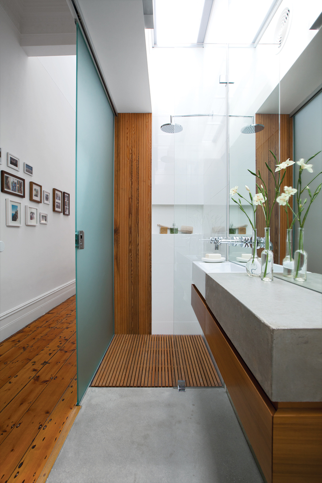 Lessons for little bathrooms in dark houses pipe perfection for Dwell bathroom designs